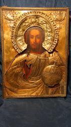 Икона Спасителя в тяжелом кованом окладе из серебра