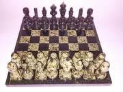 Шахматы из камня .Новые.Ширина доски 29 на 29 см. Высота пешки 50 мм.